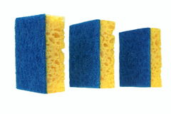 Three New Absorbent Sponge With Hardwearing Scourer Isolated On. Three New Absorbent Yellow Sponge With Blue Hardwearing Fiber Scourer Isolated On White Stock Image