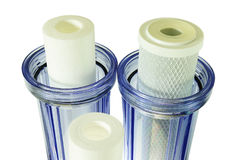 Three new household water filter cartridge & Jugs Royalty Free Stock Images