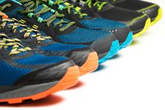Three new pairs of colourful running shoes / exercise trainers Stock Images