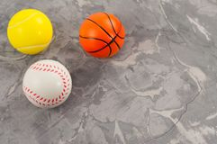 Three new soft rubber basketball and tennis and baseball balls in form of triangle stock images
