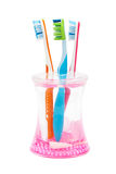 Three new toothbrushes Stock Image
