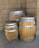 Three new wooden barrels by wall Stock Image