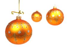 Three New Year's spheres of yellow color on white Royalty Free Stock Photos