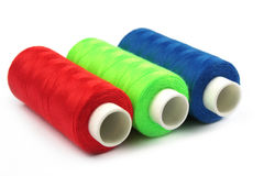Three nice colorful bobbins Royalty Free Stock Photography