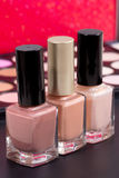 Three nice nude colors in bottles - make up accessories Royalty Free Stock Images