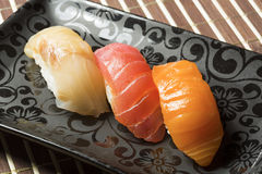 Three nigiri sushi assortment - hamachi, maguro, sake Stock Photo
