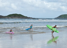Three nipper surfer life savers leave water Stock Photo