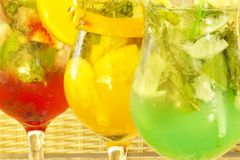 Three Nonalcoholic Cocktails. Three nonalcoholic freshening drink with mint, strawberry, orange and ice Stock Photos