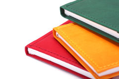 Three notebooks. Colorful notebooks on white background royalty free stock photos