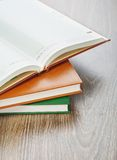 Three notebooks on wooden background Royalty Free Stock Photo