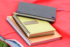 Three notepads over red mat Royalty Free Stock Photo