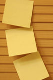 Three Notes. Stick on the wood cabinet Stock Photography