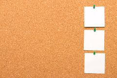 Three notes pinned to a cork Board Stock Photo