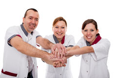 Three nurses demonstrate teamwork Royalty Free Stock Image