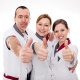 Three nurses demonstrate teamwork and success Royalty Free Stock Images