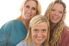 Three nurses medical females with happy expression. Group of three pretty nurses or doctors or medical professionals wearing nurse's scrub clothes and lab coats Stock Photo