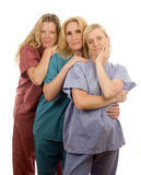 Three nurses in medical scrubs clothes Stock Photography