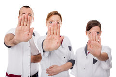 Three nurses refuses something Stock Photo