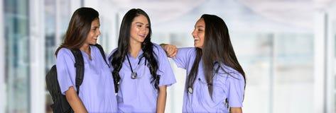 Three Nursing Students. Three happy hispanic nursing students at school royalty free stock photo