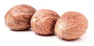 Three nutmeg whole  isolated on white background Stock Photography
