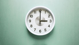 Three o`clock. Wall clock shows time three o`clock Royalty Free Stock Images