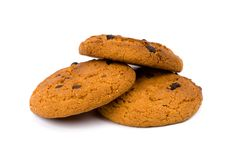 Three oatmeal chocolate chip cookies Stock Images
