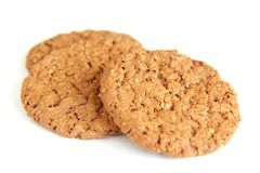 Three oatmeal cookies with chocolate Stock Photography