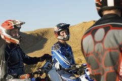 Three Off Road Motor Bike Riders Standing Together Royalty Free Stock Image