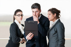 Three office coworkers looking worried Royalty Free Stock Image