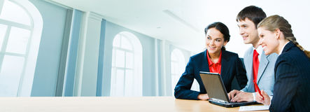 Three office workers Stock Images