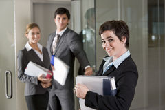 Three office workers at door of boardroom Stock Images