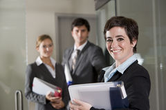 Three office workers at door of boardroom Royalty Free Stock Photos