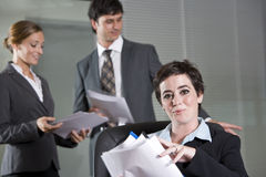Three office workers meeting in boardroom Royalty Free Stock Photo