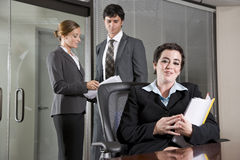 Three office workers meeting in boardroom Royalty Free Stock Photography