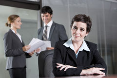 Three office workers meeting in boardroom Stock Images