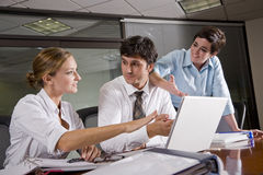Three office workers meeting in boardroom Royalty Free Stock Photos