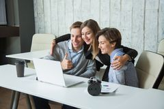 Three office workers students success achievement high-five goal. Royalty Free Stock Photo