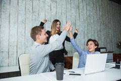 Three office workers students success achievement high-five goal. Stock Photography
