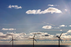 Three offshore wind turbines Royalty Free Stock Photography