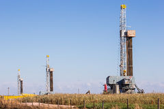 Three oil derricks. In Oklahoma plains Royalty Free Stock Images