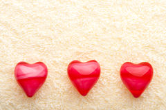 Three oil hearts on towel Stock Photo