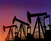Three oil wells in the desert at dusk. Illustration of three oil wells in the desert at dusk Stock Image