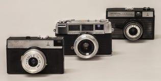 Three old analog functional cameras Stock Photo