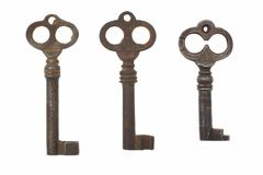 Three old antique keys on white background  Stock Images
