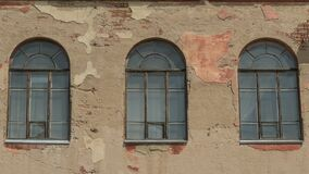 Three old arched windows of building