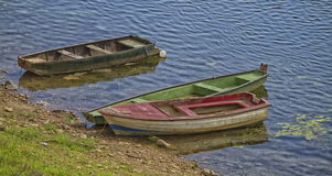 Three old boats along the river Royalty Free Stock Photos