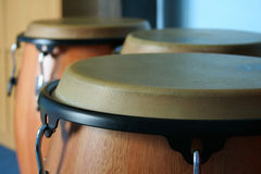 Three old bongos. Made of wood and leather Royalty Free Stock Photo