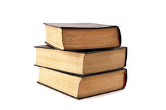 Three old books cost a pile Royalty Free Stock Photos