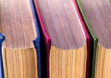 The three old books turned back side shot close-up.  royalty free stock photo