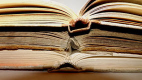 Three old books turned sideways. Side view in macro Royalty Free Stock Photo